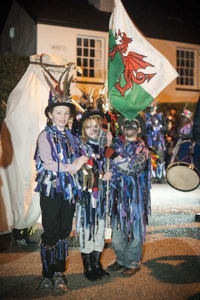 children hold the wealth flag at the mari lwyd