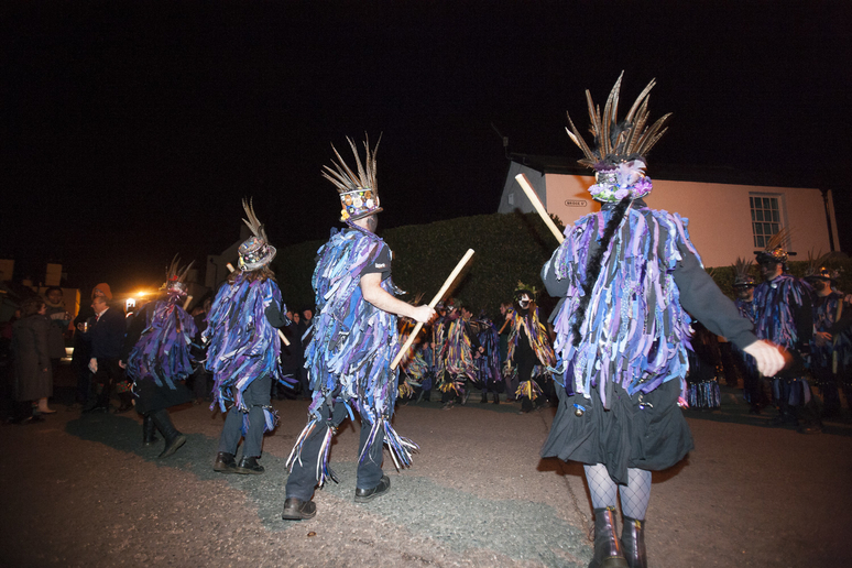 morris dancers dance in the streets of chepstow at night