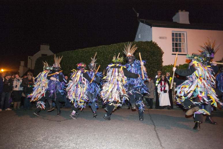 Morris dancers at night