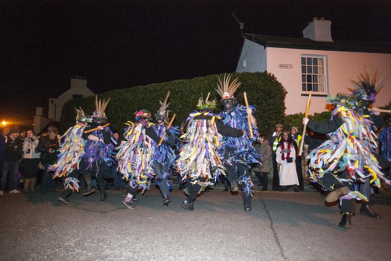 Morris dancers at night