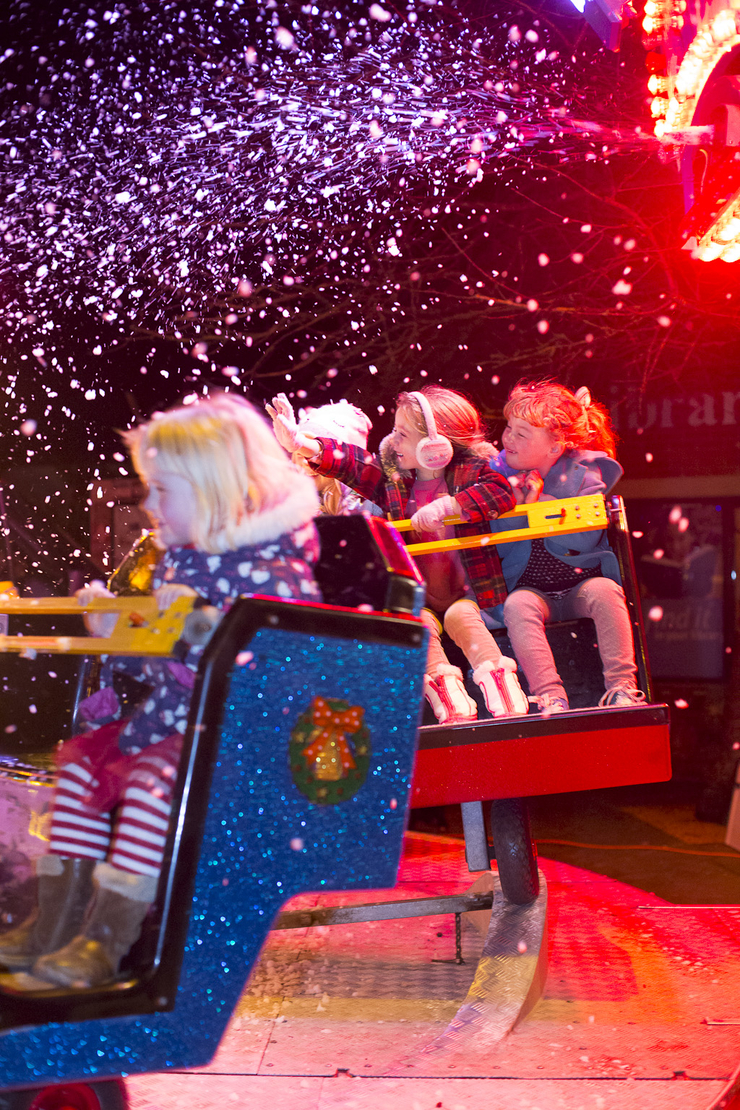 children enjoying a christmas fairground ride, Langport, Somerset tourism photographer Bill Bradshaw